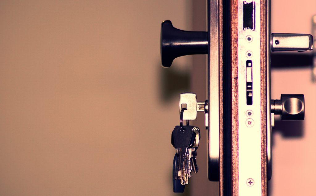 Open door with keys in the deadbolt
