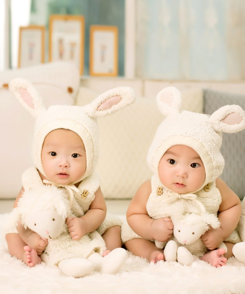 Twin babies weating bunny outfits